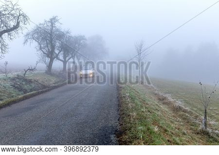 Dangerous Driving. Slippery Road. Driving Car On A Rainy And Foggy Day. Autumn Road. Car On The Road