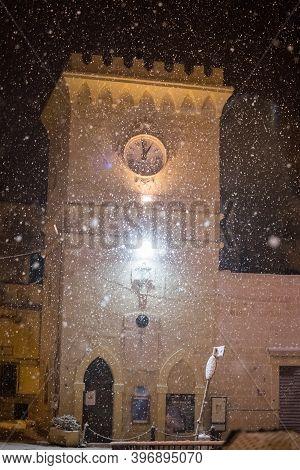 Avetrana, Italy - January 5, 2019, Clock Tower In Tiny Italian Paese Avetrana Under The Snow After A