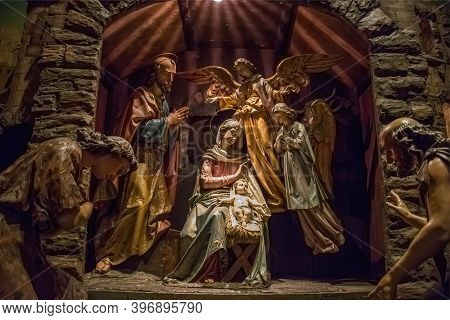 Traditional Christmas Nativity Scene With Beautiful Figures Made Out Of Wood. The Birth Of Jesus Chr