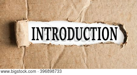 Introduction, Text On White Paper On Torn Paper Background
