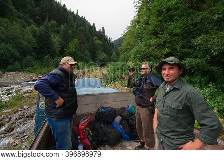 Georgia, Racha - August 16, 2013: Travelers Stand On The Truck And Have Fun,