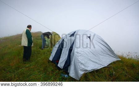 Georgia, Racha - August 18, 2013: Man And Woman Travelers Travel In Georgia, In The Mountains Of Rac