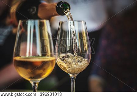 Pouring Rose Champagne Into A Glass. 2 Glasses Of Rose Champagne