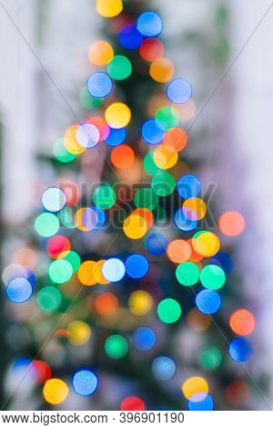 Christmas Tree In Interior With Defocused Lights And Star. Christmas Abstract Blur Background. Out O