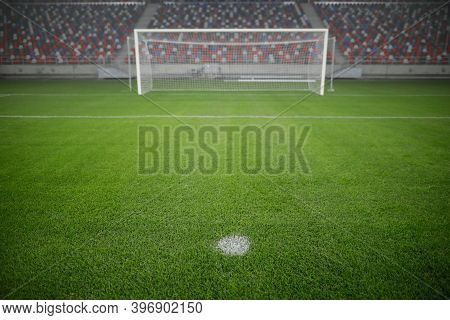 Shallow Depth Of Field (selective Focus) Image With The Penalty Kick Point On An Empty Soccer Stadiu