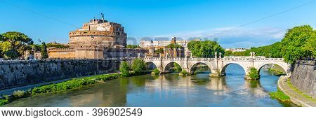Castel Sant Angelo And Ponte Sant Angelo, Reflected In Tiber River In Rome, Italy.