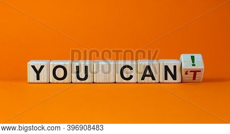 You Can Concept. Turned A Cube And Changes The Words 'you Can't' To 'you Can'. Beautiful Orange Back