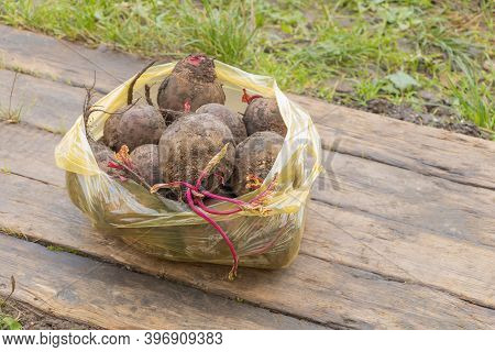 Beetroot On Wooden Background In A Bag. The Benefits Of Beetroot Concept