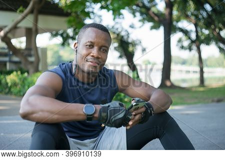 Muscular Black Man Smiling, Confident And Relaxed, Chatting On  Smartphone. African American Male Sp
