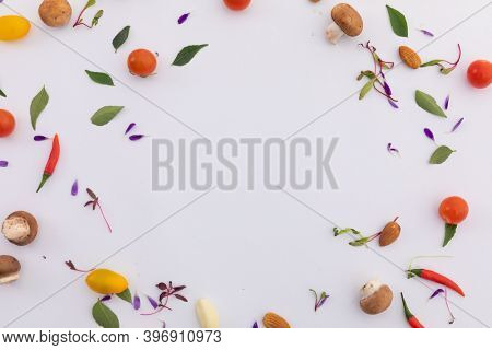 Fresh vegetables and leaves arranged in circle on white background. fresh produce green vegetables healthy eating organic food preparation concept.