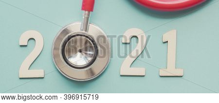 2021 Wooden Number With Red Stethoscope. Happy New Year For Health Insurance And Medical Concept,  N