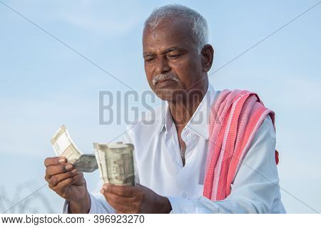 Indian Farmer Angry About His Income Due To Low Crop Yield, Profit Or Loan Repayment While Counting