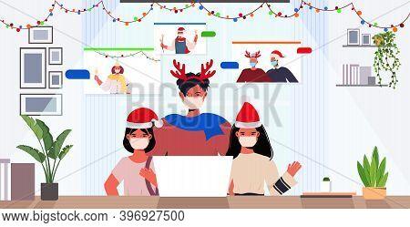 Multi Generation Family In Santa Hats Discussing During Video Call Coronavirus Quarantine Concept Ne