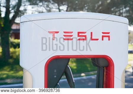Bordeaux , Aquitaine  France - 11 21 2020 : Tesla Logo Sign On  Supercharger White And Red Station C