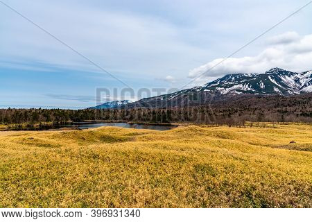 Beautiful Lake And Rolling Mountain Range On Springtime Sunny Day. High Latitude Country Natural Bea