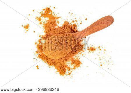Dry Turmeric Powder Or Curcuma Longa Linn In Wooden Spoon Isolated On White Background.