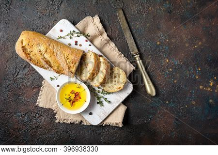 Loaf Of Bread With Olive Oil, Vintage Knife And Spices
