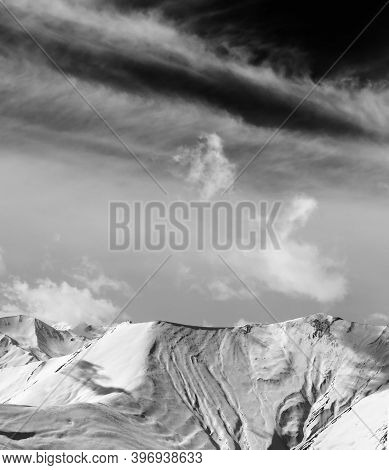 Black And White View On Off-piste Snow Slope And Sky With Clouds At Wind Day. Caucasus Mountains In