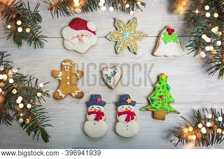 Christmas Cookies On A Table With Winter Holidays Festive Decorations And Symbols Top View Flat Lay