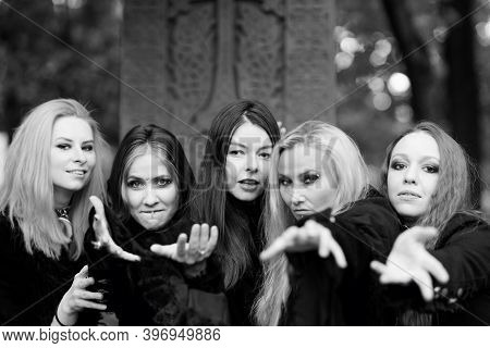 Coven Of Witches, A Group Of Different Friends As Witches Meet Halloween. Young Women In Black Cloth