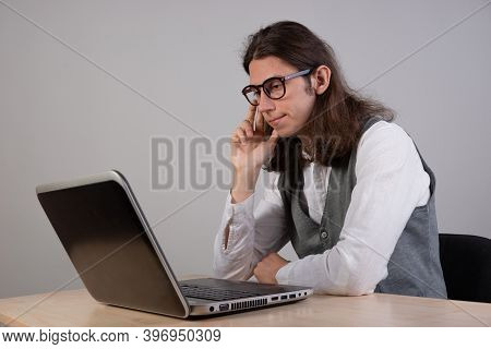 Geek Guy Is Trying To Write Code Or Learn A New Programming Language, Experience Difficulties In The