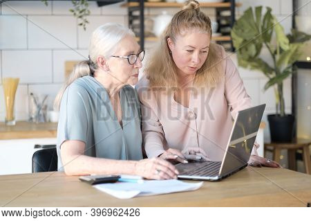 Daughter Helps Her Elderly Mother Figure It Out Online With Her Personal Account. Woman Teaching Sen