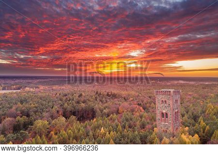 798/5000 Sunset Over The Green Forest, Near The Town Of Żary With The Observation Tower In The Backg