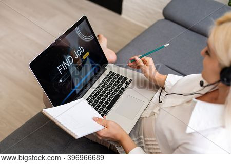 Online Job Hunting Hands With Computer Reading Employment Ads