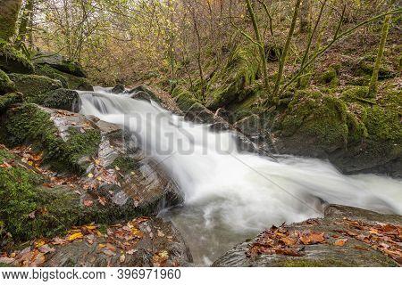 Long Exposure Of A Waterfall On The Hoar Oak Water River At Watersmmet In Exmoor National Park In Au
