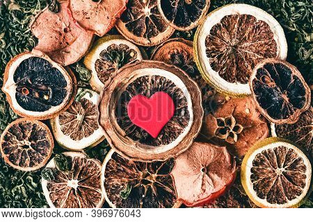 Background Of Various Dried Fruits Lying In Loose Tea And Heart In The Middle .collage Of Tea Paraph
