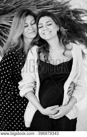 Lovely Middle Aged Woman Hug Her Pregnant Daughter, Smiling, Caring Grandmother With Young Mother En