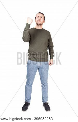 Full Length Portrait Of Furious Man, Displeased Emotion, Shows Clenched Fist To Someone, Isolated Ov