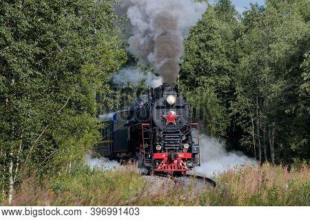 Ruskeala, Russia - August 15, 2020: The Ruskeala Express Retro Train Exits The Turn