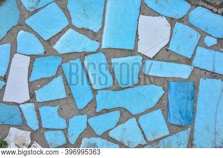Texture Of Pieces Of Blue Ceramic Tiles. Blue Broken Ceramic Tile Mosaic Background. Broken Tiles Mo