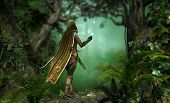 a hunter in a hooded cape passes through the forest poster