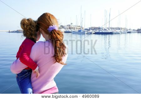 Mother And Daughter Hug Looking Blue Marina
