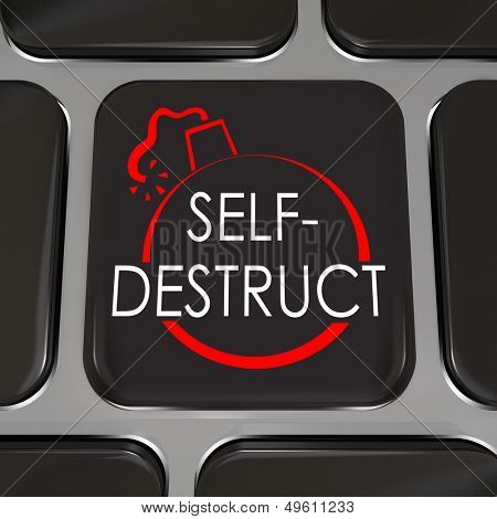 The words Self-Destruct and a bomb picture on a black computer keyboard key to illustrate giving up, quitting and admitting defeat