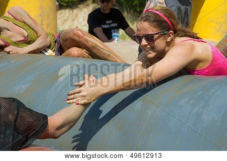 Woman getting help to finish the course