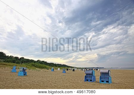 Hooded beach chairs at the Baltic sea in Heringsdorf, Mecklenburg-Vorpommern state, Germany poster