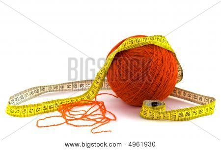 Red Clew And Measure Tape