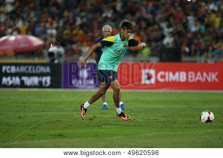 KUALA LUMPUR - AUGUST 9: FC Barcelona 's Neymar Jr. practices during training at the Bukit Jalil Stadium on August 09, 2013 in Malaysia. FC Barcelona is on an Asia Tour to Malaysia.