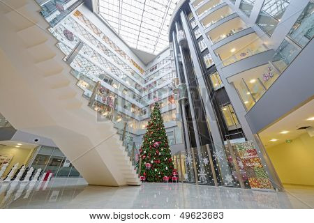 MOSCOW - DEC 20: Christmas tree and a large chess in Main office Rosbank on December 20, 2012 in Moscow, Russia.