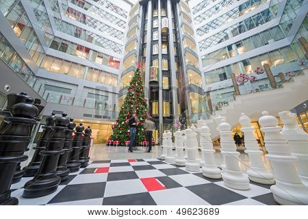 MOSCOW - DEC 20: Large chess and a Christmas tree in Main office Rosbank on December 20, 2012 in Moscow, Russia.