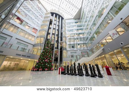 MOSCOW - DEC 20: Hall with a Christmas tree and a large chess in Main office Rosbank on December 20, 2012 in Moscow, Russia.