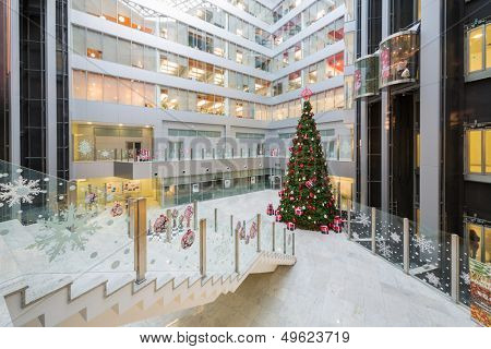 MOSCOW - DEC 20: Hall with a Christmas tree in Main office Rosbank on December 20, 2012 in Moscow, Russia.