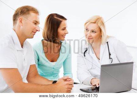 healthcare, medical and technology - doctor with patients looking at laptop poster
