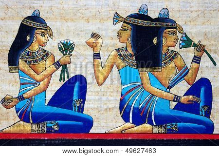 beautiful egiptian papyrus - three girls holding a lotus flower - beauty concept