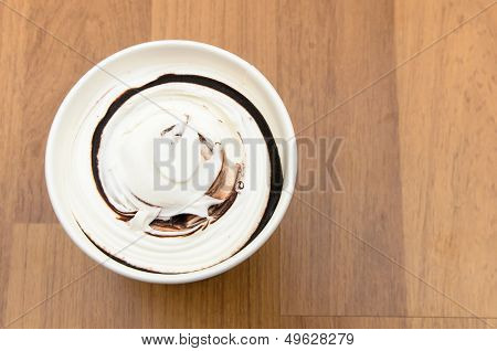 Top View Of Ice Cream Cup On The Wooden Table