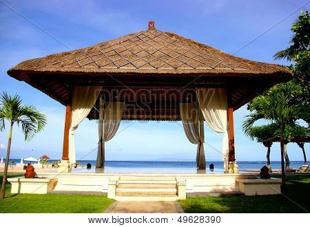 pictorial view with Balinese bower on the beach