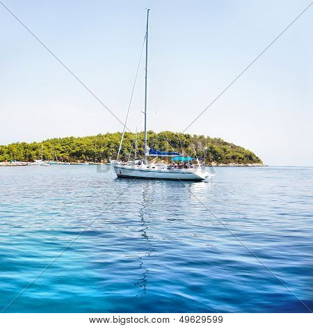 turquoise Adriatic sea with yacht